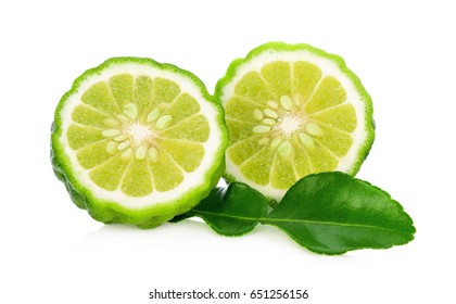 A Half of bergamot fruit with green leaf isolated on white background