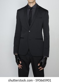 half body business man in black suit with gloves