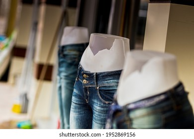 Half body female dummies with broken bellies with blue jeans on for demonstration. Aggression against women, oppression, pressures, beauty and health issues concepts.