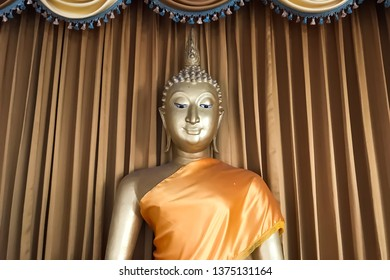 Half body of golden buddha statue with smiling face