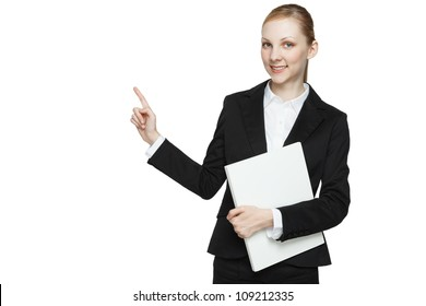 Half body portrait of young businesswoman with blank sign pointing, white background with copy space.