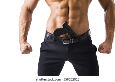 Half body Shot of a Handsome Athletic Man with no Shirt with Handgun Shoved in His Pants. Isolated on White Background.