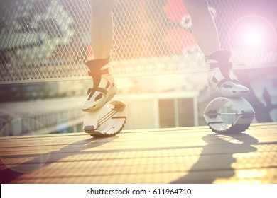 Half body of an unidentified people wearing kangoo shoes for exercises fitness.
