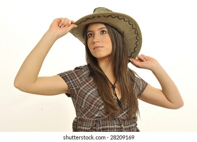 Half body view of young fashion model in country wear with cowboy hat. Isolated on white background.