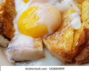 Half boiled eggs on toast for breakfast