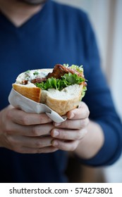 Half bread sandwich with meatballs, tomato and lettuce (typical Turkish street food)