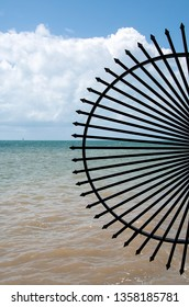 half circular black wrought iron fence with Gulf of Mexico background