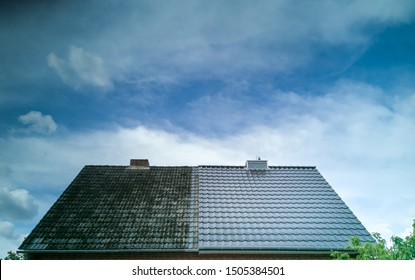 A half cleaned house roof shows the before and after effect of a roof cleaning. - Shutterstock ID 1505384501