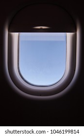 Half closed air plane window with blue sky background