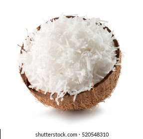 half of coconut with coconut flakes isolated on the white background