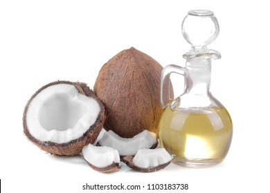 half coconut with slices of coconut and coconut oil on white background isolated