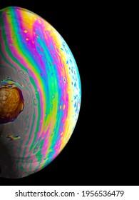 Half colourful soap bubble on black background