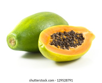 Half cut and whole papaya fruits on white background