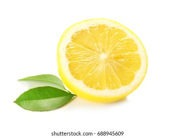Half of delicious lemon and green leaves on white background