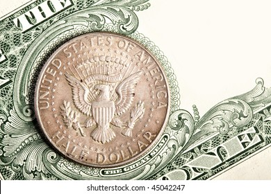 Half dollar coin close up on banknote