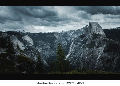 Half Dome with dark clouds