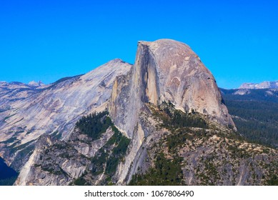 Half Dome is a granite dome at the eastern end of Yosemite Valley in Yosemite National Park, California. It is a well-known rock formation in the park, named for its distinct shape.