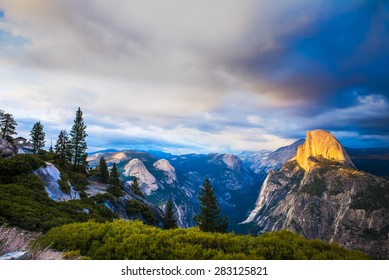 Half Dome Rock Yosemite National Park at Sunset.  Forest in foreground.
