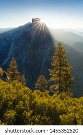Half Dome and Yosemite Valley in Yosemite National Park during colorful sunrise with trees and rocks. California, USA Sunny day in the most popular viewpoint in Yosemite Beautiful landscape background