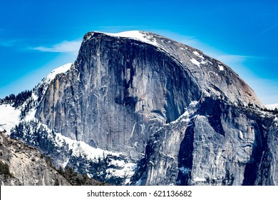 The Half Dome/Half Dome shines in the blue sky in magnificent nature.