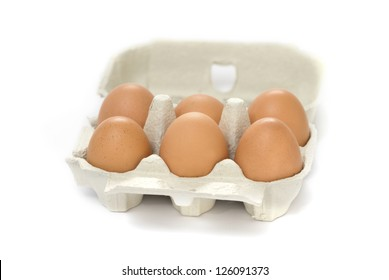 Half a dozen eggs in a cardboard carton