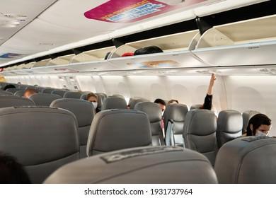 Half empty cabin of a passenger plane. Empty seats for passengers. Airplane interior. Turkey , Istanbul - 21.07.2020