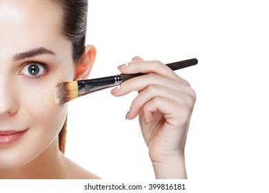 Half face of Beauty Girl with Makeup Brushes. Natural Makeup for Brunette Woman with blue Eyes. Makeover. Perfect Skin. Ideal for commercial. Part of face