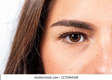 Half face of brunette