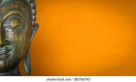 half face Buddha orange background