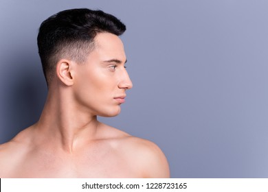 Half face close up portrait of good-looking confident man turn head aside stand isolated on gray wall