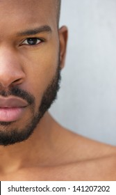 Half face portrait of a handsome young african american man shirtless