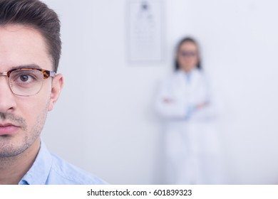 Half face portrait of man wearing designer eyeglasses