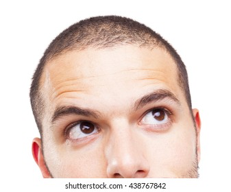 Half face of a young man looking up, isolated on white background