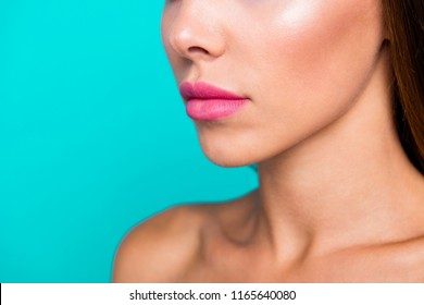 Half faced turned close up studio photo portrait of charming pretty attractive lady with perfect nice soft moisturized skin isolated on blue bright background