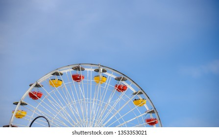 Half of Ferris wheel with background of blue sky.