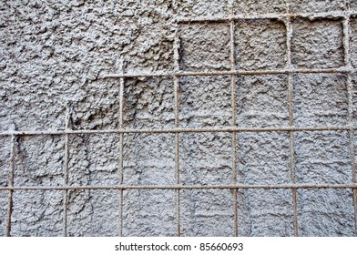 Half finished concrete wall with armour