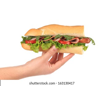 Half of french baguette sandwich in hand. Isolated on a white background.