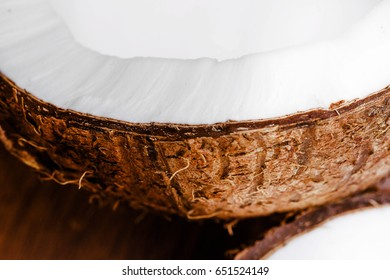 Half of fresh coconut lies on the table