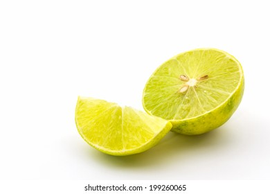 Half of fresh limes on white background.