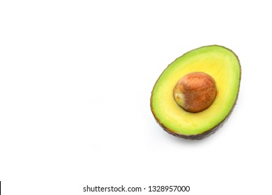 A half of fresh ripe avocado with seed isolated on white background