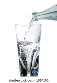 Half full glass being filled with water isolated on white