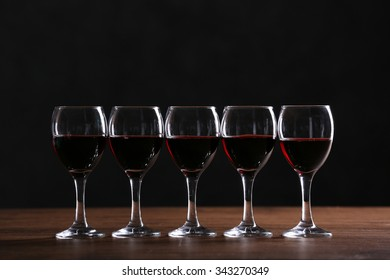 Half full wine glasses on a table