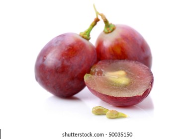 An half and fullness grapes with seeds isolated over white background.
