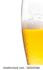 half glass of fresh beer with drops on white background, with space for text