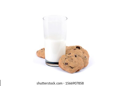 half glass of milk and homemade chocolate chip cookies isolated white background