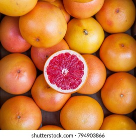 half a grapefruit on a background of grapefruit