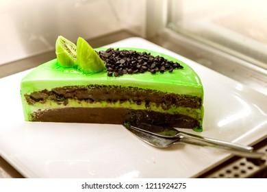 half a green cake with chokolate and kiwifruit