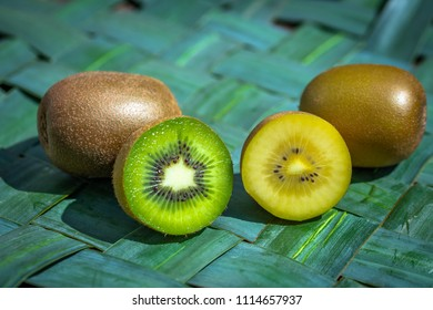 half green kiwi and half yellow kiwi side by side