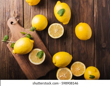 Half of lemon on a wooden board.