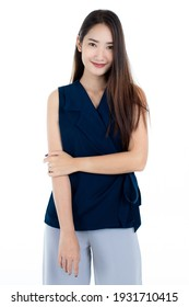 Half length body shot of cute delighted young Asian woman smiling and looking at camera isolated on while background